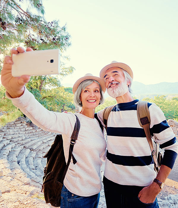 Older couple on vacation in front of old ruins